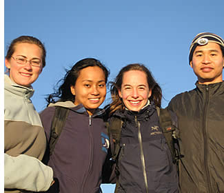 Teacher with students at the top of the Volcan Baru